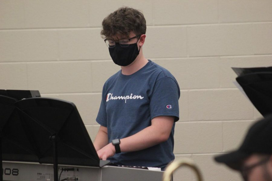 Sophomore Jack Kuhns plays the piano during a jazz band rehearsal. The jazz band has in person rehearsals twice a week.