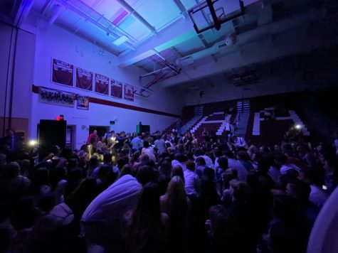 That's a lot of people! Students fill the dance floor at the homecoming dance. At last year