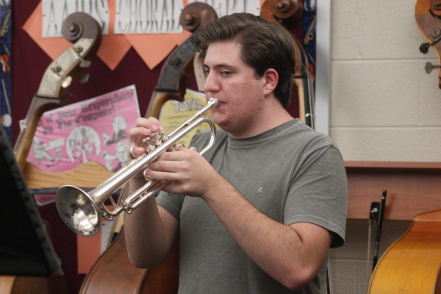 Junior Quinn Moseby works on his solo part in the song