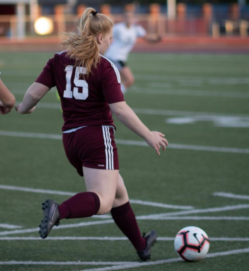 Shoot! Junior Becca Dull passes the ball to a teammate during the Oct. 2 game. The Mountain Lions competed against Dubois and won 4-0.