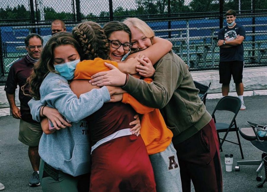 Score! Sophomore tennis player Morgan Stevens's friends, Isabella Frank, Eve Hogan and Alaina Keolhle congratulate her on her big win.