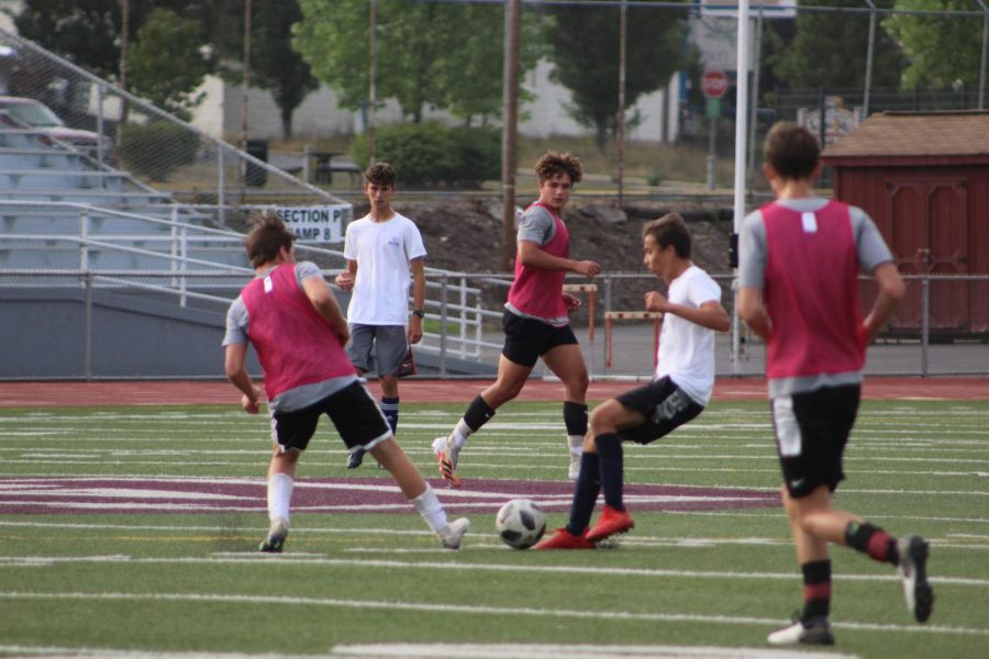 Kick+it%21+In+a+preseason+game+against+Holidaysburg%2C+junior+soccer+player+Will+Young+kicks+the+ball+to+his+teammate+senior+Austin+Kravetz.+The+varsity++team+is+currently+4-1+and+the+next+game+is+on+Saturday%2C+Oct.+10.%0A+