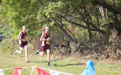 Long Run! Two young men run during a meet. The two people on the boys cross country team ran in one of last years meets.