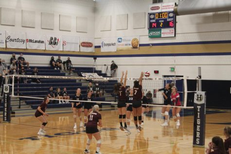 Altoona Lady Spikers Freshman Addie Cooper and Freshman Aunye Counsman make a block against the Hollidaysburg team.