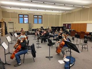 Getting Ready! The orchestra participates in their second practice at the junior high. The orchestra got ready for their second in-person class meeting, were six  feet apart and everyone wore masks.