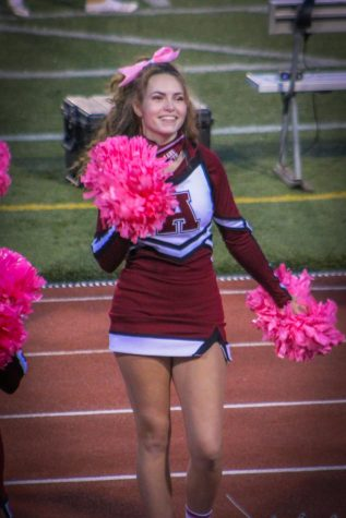 Go Mt. Lions! Caleigh Rudy cheers on the football team. Rudy and the rest of the squad wore pink to show support for breast cancer.