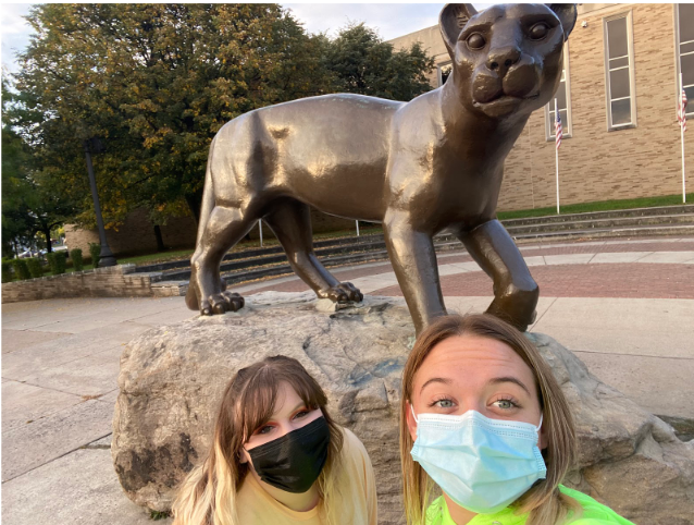 Scavenger hunt Jocelyn Fetter and Layla Shelow pose with the lion statue as they take photos for a scavenger hunt competition.  Fetter's team won the friendly competition.