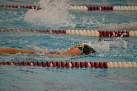 "At a 2019 swim meet, then junior Makenna Murphy swims backstroke during the 200 IM. ""I"