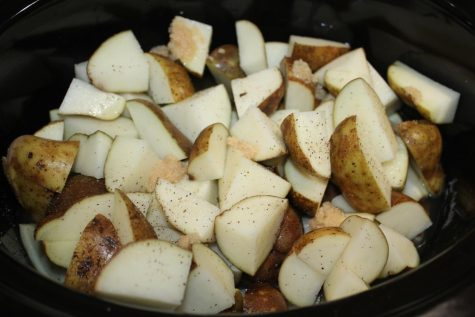 Once the potatoes, chicken broth and seasonings are in the crock pot, let them sit for six hours on a medium heat. The potatoes should be soft enough to mash when the six hours are over.