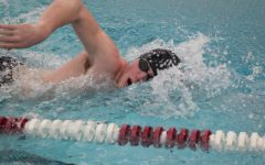 Senior Kyle Murray takes a breath while sprinting in the 100 yard freestyle. This is Murray's first year on the team.