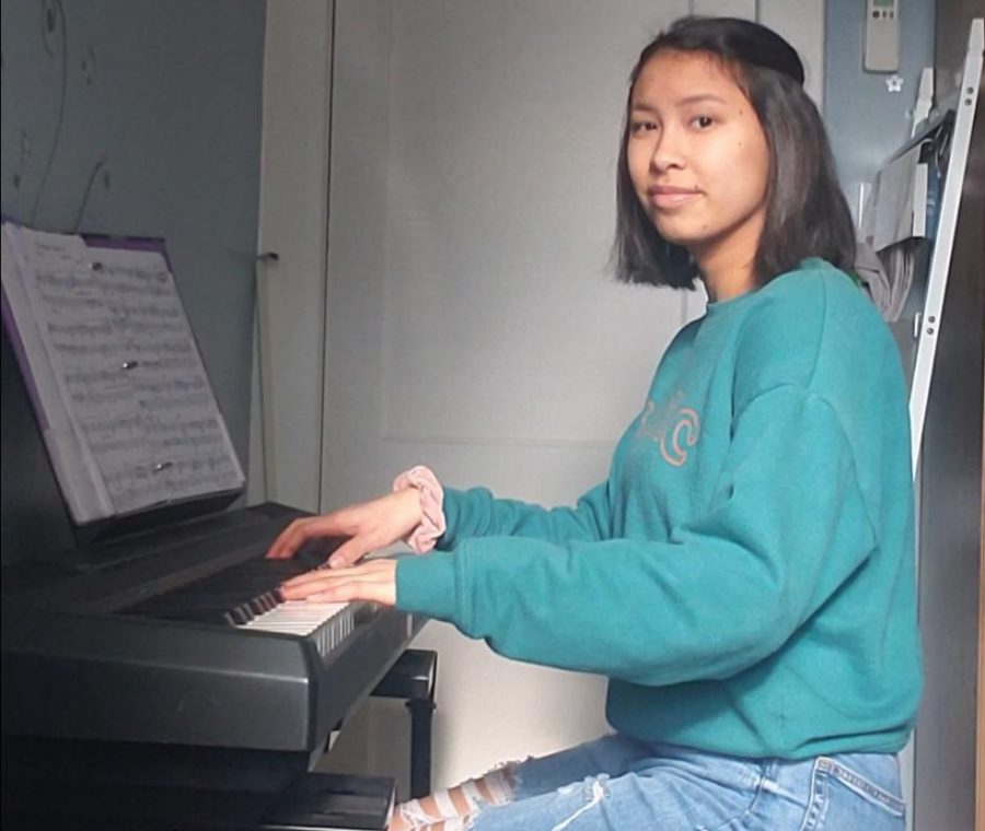 Practice practice practice! Sophomore Katie Hovan plays her piano at home. Many students, like Hovan, learned how to play an instrument both outside of school and in school.