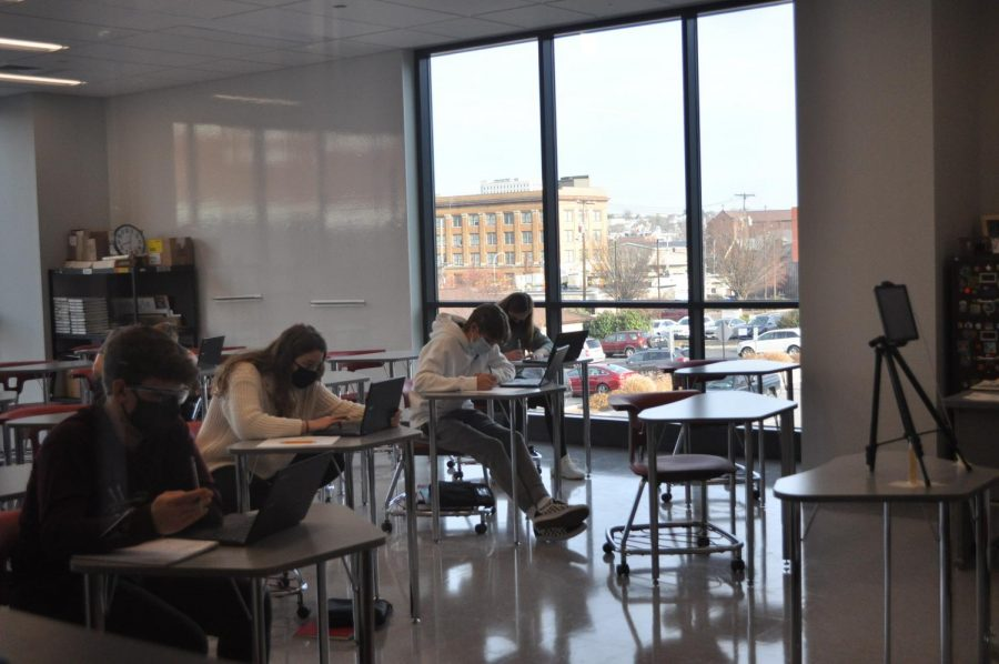 Because of the hybrid schedule, classroom sizes have largely been decreased. The students work while wearing masks and following the proper safety guidelines.