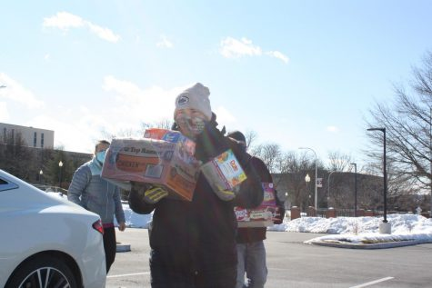 Brr! Volunteer Paul Caracciolo III carries boxes of food to the truck where it is donated. There were 11 skids worth of food donated.