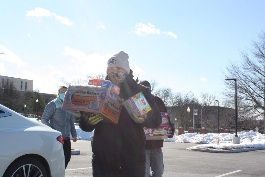 Brr%21+Volunteer+Paul+Caracciolo+III+carries+boxes+of+food+to+the+truck+where+it+is+donated.+There+were+11+skids+worth+of+food+donated.