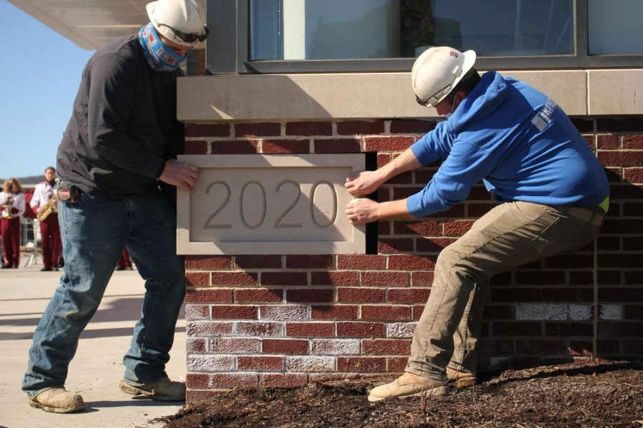 Reflecting on 2020. Stone mason Keith Morgan and his crew install the time capsule on Thursday, Feb. 25. The time capsule is filled with items and memorabilia that represent the year of 2020.