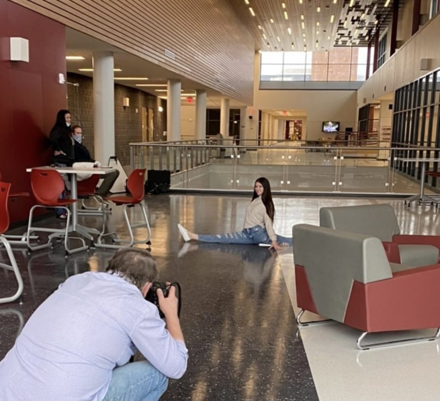 Split! Makenna Taddy does a split as Tim Boyles takes her picture. In addition to a senior headshot, Boyles also took a more candid photo.
