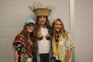 Aloha! 2020 seniors, Julia Whiting, Gianna Caputo and Maddie Kanouff, pose for a picture during the 'Tourist' theme day. Whiting ran for Key Club during the 2020 Homecoming.