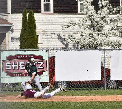 SAFE! Sophomore Bryce Eberhart slides into third base. Eberhart stole third attempting to make it home before the end of the inning.