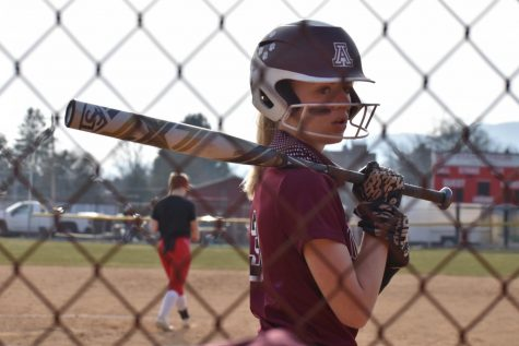Senior Ashley Steinbugl prepares for a game, playing one of the last few games left of the season. Steinbugl plays softball with her sister senior Riley Steinbugl.