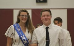 During last year's Homecoming assembly the  representative of the swim team, Faith Milliron, and her escort, Rusty Focht, smile wide for the camera. This year, there will be no homecoming dance, but there will be a scavenger hunt and games night.