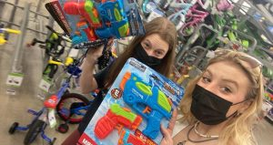 We got it! Seniors Abbie Starr and Ashley Steinbugl take a selfie while buying their water guns. Starr and Steinbugl lasted until the third round.