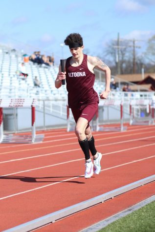 George Boutiller runs during the track meet on April 13 against Harrisburg. The team won that meet 109-23.