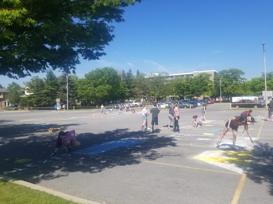 On+May+19%2C+seniors+gathered+in+the+student+parking+lot+to+decorate+parking+spaces.+The+event+took+place+during+senior+week.+