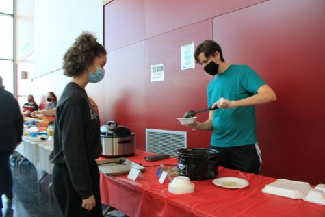 Senior Alex Thaler dips out food during the foreign language club (FLC) food event. During this event, FLC students made food from different country origins. The students then brought this food in to share with the school.