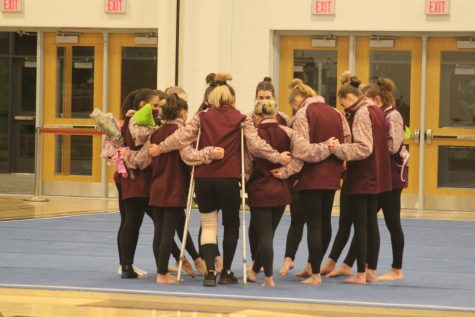During the girls gymnastics senior night, they gather around in a circle. Gymnastics can be really fun even if you dont have a background in anything. We will teach you and you can be good at doing this if you put your heart in it, senior Cassandra Kyle said.