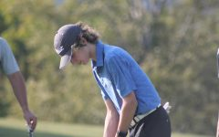 Swing! Sophomore, Trent Myers gets ready to swing his club. Myers was also on the golf team last year.