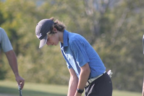 Swing! Sophomore, Daniel Batrus gets ready to swing his club. The golf team plays on many local courses including Park Hills.