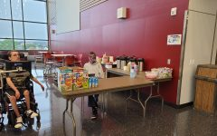 Guess whos back!  Students sit at the coffee cart during the first teacher only opening. They prepared all the items and are ready for the student opening on Sept. 20.