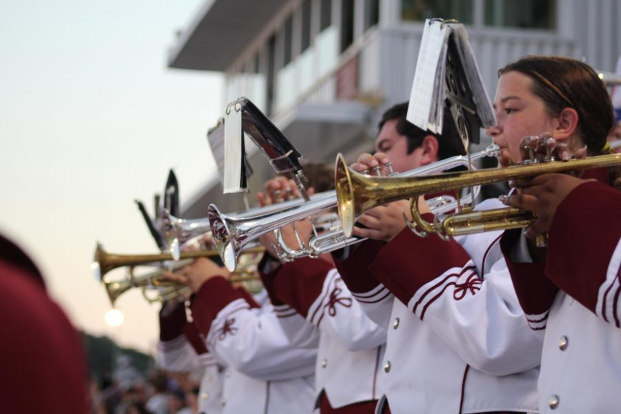Senior Quinn Mosebey, Junior Austin Parker, Sophomore Mackenzie Colabove  and sophomore Aaliyah McGee play at the home football game. Marching band performed at game during halftime.
