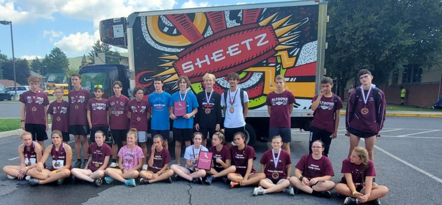 Both girls and boys varsity win first place. The two varsity teams took home first place plaque.