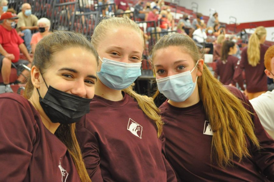Three seniors (left) Macy Yost, (middle) Evelyn Stroup and (right) Kaylee Smith prepare for their home game against the Hollidaysburg volleyball team.