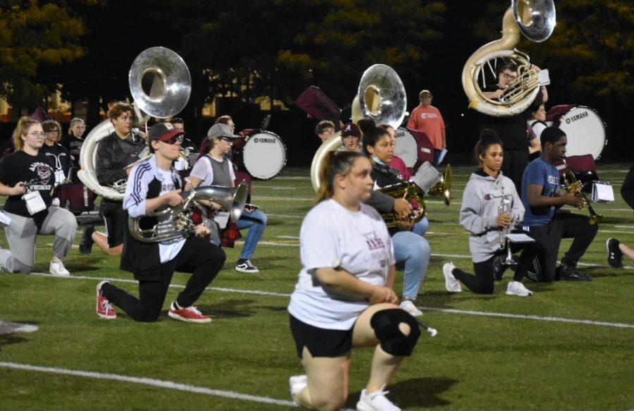 Take a knee Band practices recognizing the seniors for the last home football game of the year. The band had three practices to prepare.