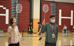 Both rackets in the air Senior George Boutiller and junior Jocelyn Stout play badmitten in second period. I think that the no-suits are necessary to have kids willing to participate in gym, Boutiller said.