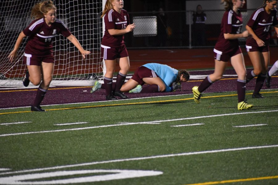 """Senior Madison Cabell dives for the ball. Madison Cabell is the senior goalie. """"We are all a lot closer this year and we all have one goal and we've had the same goal since freshman year,"""" Cabell said."""