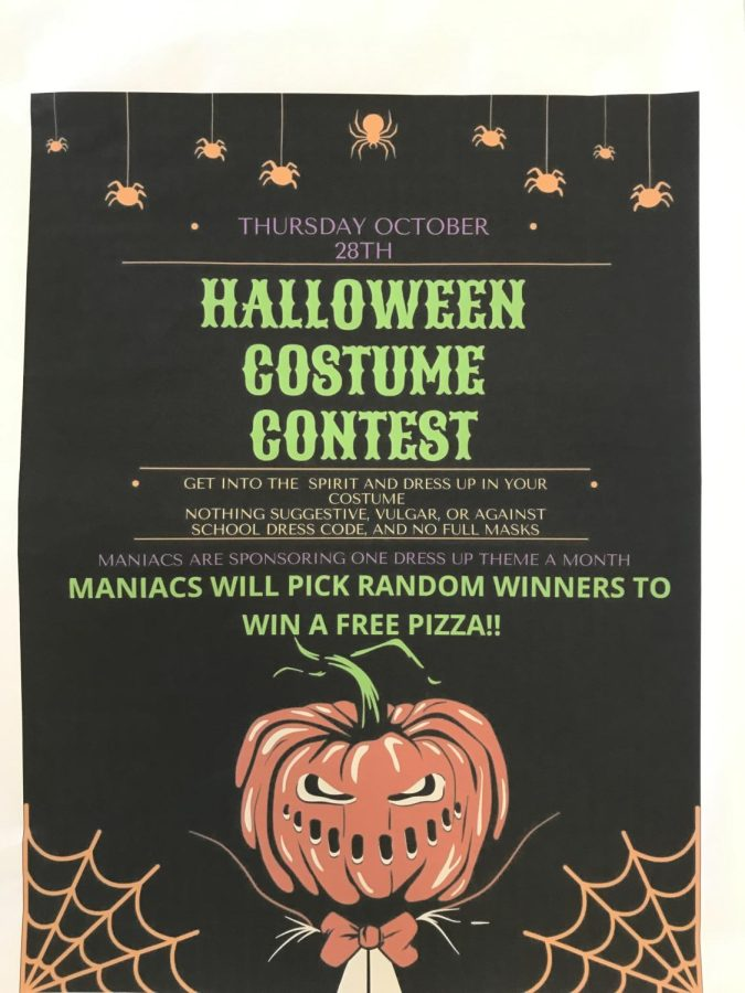 Spook The costume contest posters hang in main hallways. The costume contest will be held thursday, October 28.