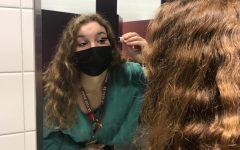 Sophomore Olivia McMinn applies mascara. McMinn got ready for the day ahead by applying makeup.