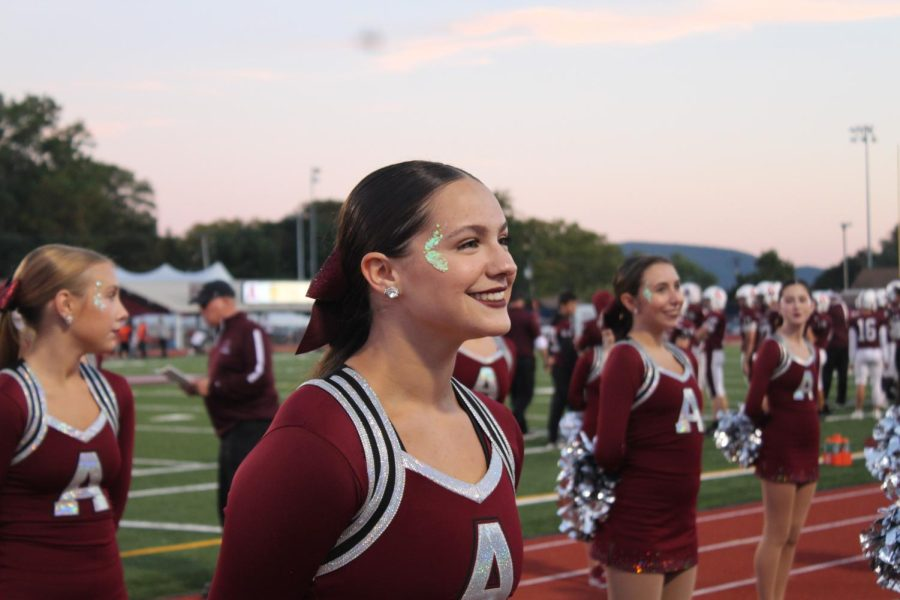 All smiles here On Oct 1, junior Emma Peterman prepares to dance for the Homecoming football game. Peterman danced for the Lioneers dance team and practiced twice a week.