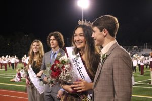 Smiles Seniors Brooke Harrington and Will Young smile after Harrington is crowned Homecoming queen. She explained that she worked hard during Homecoming week.