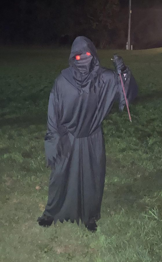 Boo! A student scares guests with his glowing red eyes. A speedy black figure was seen roaming the entrance area sneaking up on people.