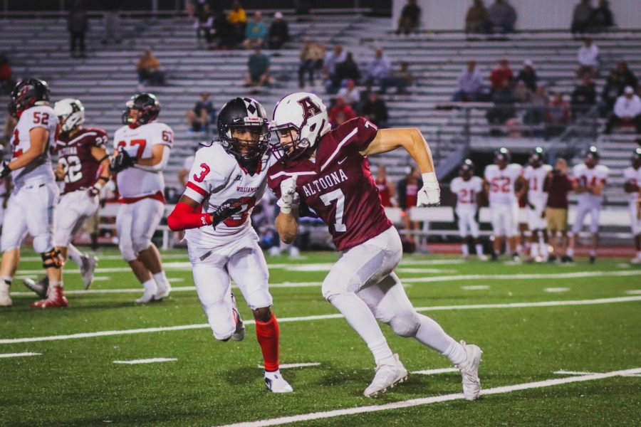 Racing against the clock Junior Sean Bettwy sprints towards the ball carrier to make the tackle. Hes been playing on defense for most of the season.
