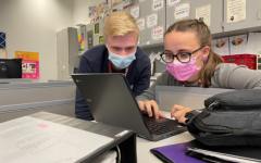 Working on it Junior Eli Peteuil and Editor in Chief, senior Destiny Montgomery go over a story in time to publish for the story rotation due date.