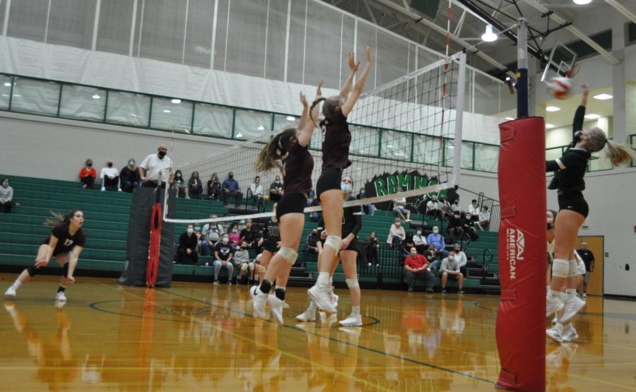Fierce competition! Senior Kaylee Smith and junior Emma Clouser blocks the ball against the opposing team. Volleyball is a passion that I have. Ive worked hard for the skills I show on the court when in defense and offense, Smith said.