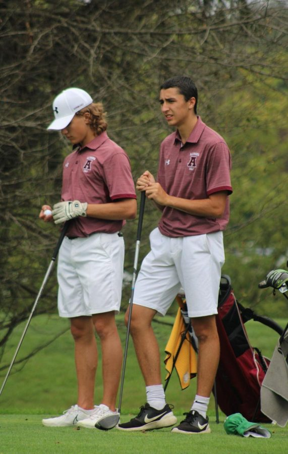 Getting ready for the match Senior Jordan Lestochi stands on the golf course waiting for his turn.